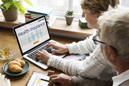 Health Insurance Enrollment on Computer