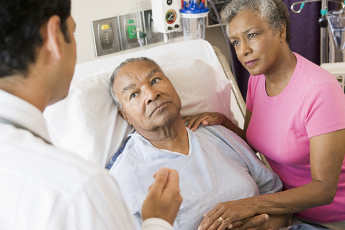 Hospitalized man and wife listening to doctor